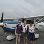 Leah, Steph, and Gina Belknap, Southeast Region (SER) Facility Management Systems Specialist (Network), prepping for plane ride over Cape Hatteras National Seashore, June 2015