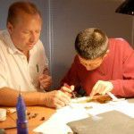 Curtis Desselles and Houren Zhu build and test eddy current analyzers.