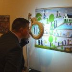 Randy Deaton takes a close look at a Toye forgery at the Gallery 2 show