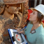 Hallett investigating the condition of the 16th century terracotta roundels at Hampton Court Palace.