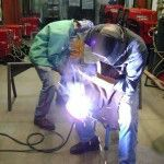 Vern Mesler welds a wrought iron during the workshop.